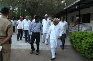 IAS officer of the region having a talk with Justice Patil